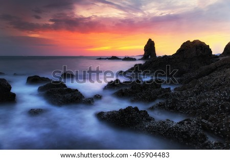 Seascape Thailand, the waves ripple rock and sunrise at the beach beautiful landscape. - stock photo