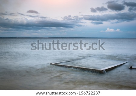 Seascape. The composition of nature. Concrete slab in the water. - stock photo