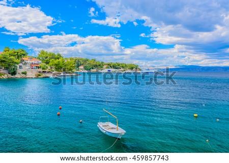 Seascape waterfront view at Island of Solta, wit Rogac mediterranean town in background, Croatia summertime. / Solta Rogac seascape. / Selective focus. - stock photo
