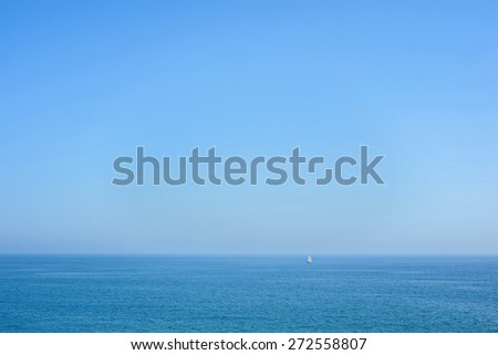 Seascape with blue sea,sky and small yacht - stock photo