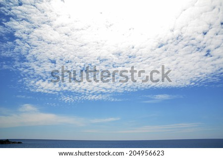 Seascape with clouds - stock photo