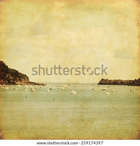 Seascape with fishing boats in grunge and retro style. - stock photo