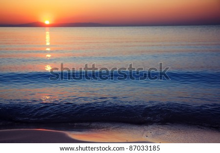 Seascape with sunrise at the horizon. Natural darkness and colors - stock photo
