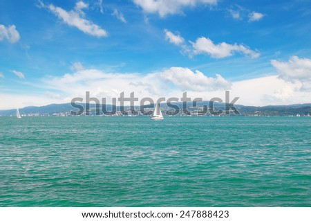 seascape with turquoise waters and sailing vessel - stock photo
