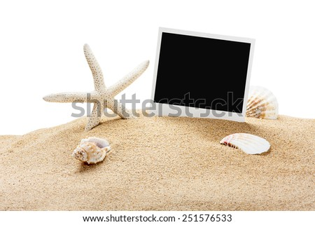 seashells and old picture frame isolated on white background - stock photo