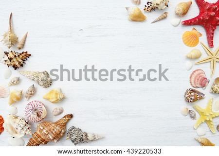 Seashells and starfish on a white wooden background - stock photo