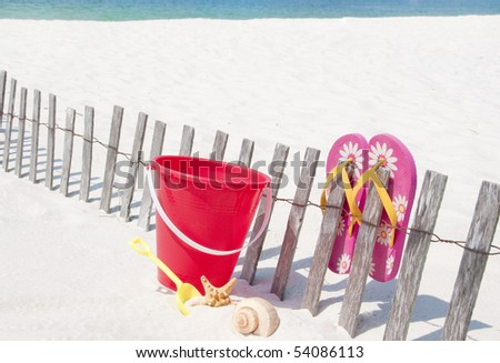 Seashells on beach by toys - stock photo