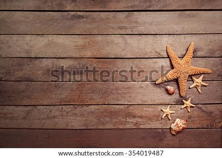 Seashells on brown wooden background - stock photo