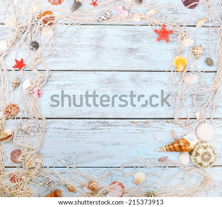 Seashells on wooden background - stock photo