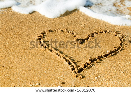 Seashore with surf line making heart shape - stock photo