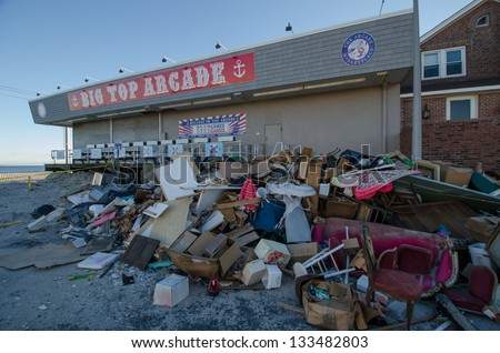 SEASIDE HEIGHTS, NJ/USA - JANUARY 18: Debris caused by hurricane Sandy damage is piled outside a boardwalk arcade on January 18, 2013 in Seaside Heights, New Jersey. - stock photo