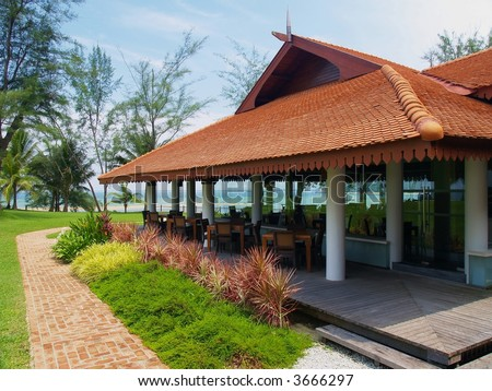 Seaside restaurant at a tropical resort - stock photo