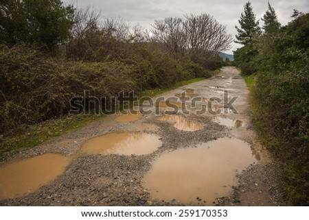 Season of bad roads. Spring roads after heavy rain at Evbia, Greece - stock photo