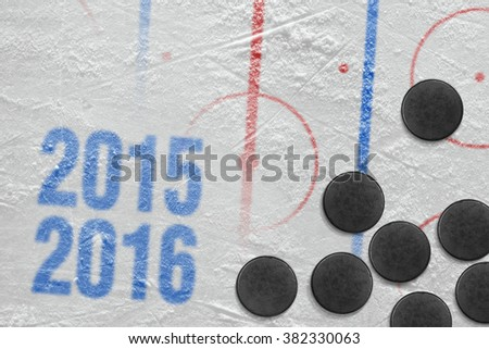 Season 2015-2016 year and hockey puck on ice. Concept - stock photo