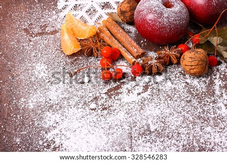 Seasonal old wooden table with apple, cinnamon and anise. Christmas time background. - stock photo