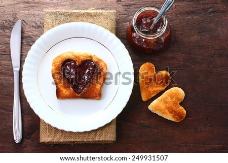 Seasonal table for Valentine's love with a delicious breakfast. - stock photo