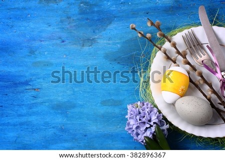 Seasonal table with cutlery and easter eggs. Easter background. - stock photo