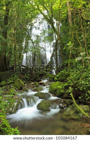 Seasonal waterfall and pool seen through the forest at Rinc�³n de la Vieja National Park in Costa Rica - stock photo