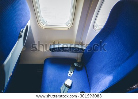 Seat belt in airplane  ( Filtered image processed vintage effect. ) - stock photo