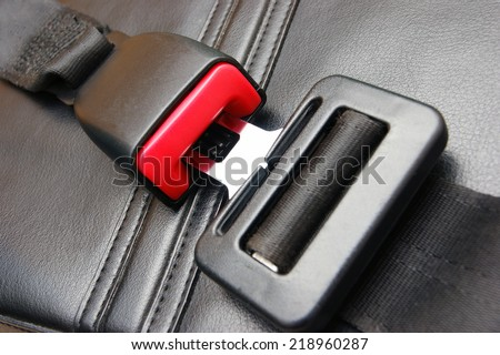 seat belt on a black leather chair - stock photo