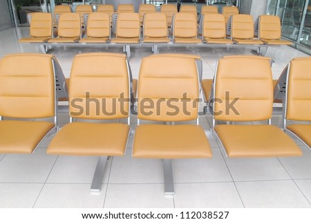 seat in airport terminal - stock photo