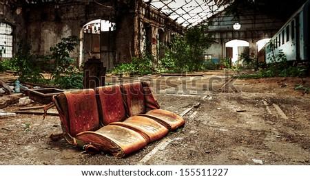 Seat of a train at abandoned depot closeup photo - stock photo