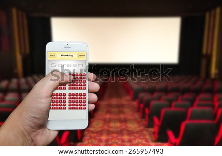 Seat reserved by smart phone application. - stock photo