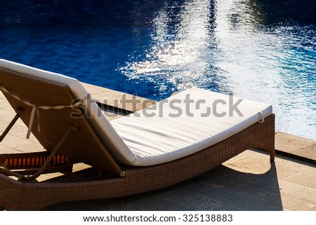 seat side by pool - stock photo