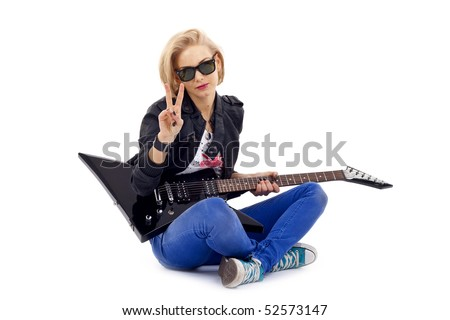 seated woman guitarist making a peace gesture - stock photo