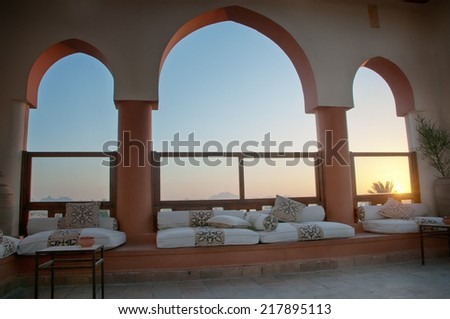 Seating Area with Sofas near Arched Windows at Sunset, Egypt - stock photo