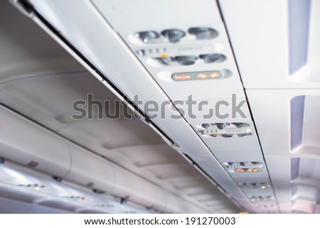 Seating for passengers in an airplane - stock photo
