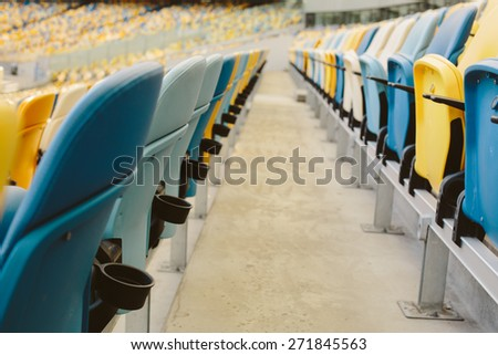 Seats in the stadium - stock photo