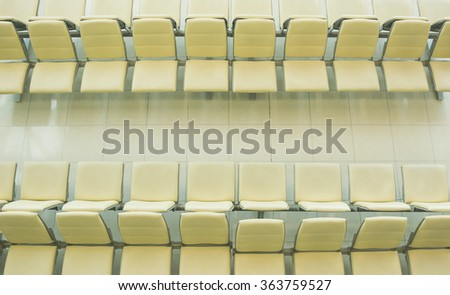 Seats row in rest area of airport in thailand - stock photo