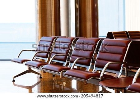 Seats, view from waiting room. - stock photo