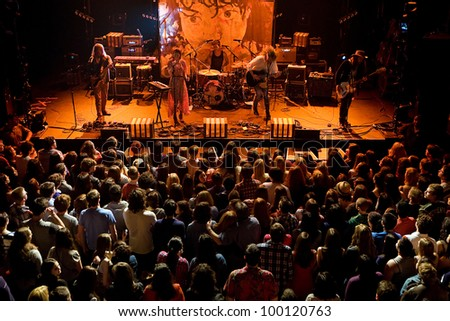 SEATTLE - April 7:  Indie Rock Band Grouplove perform on stage at the Moore Theater in Seattle on April 7, 2012. - stock photo