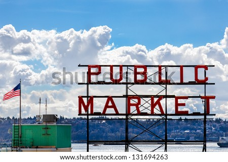 SEATTLE-APRIL 6: The red neon Public Market sign above the famous Pike Place Market in Seattle, WA on April 6, 2012. The market is one of the oldest public farmers' markets in the USA. - stock photo