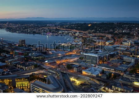 Seattle buildings and Union Lake at twilight - stock photo