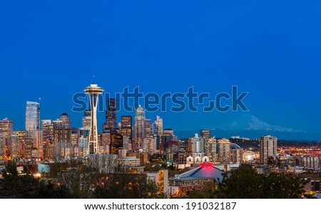 Seattle downtown skyline and Mt. Rainier at night, WA from Kerry park - stock photo