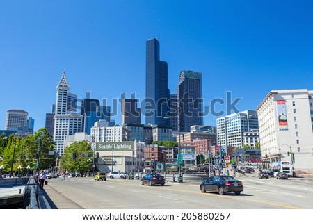 SEATTLE - JULY 5: Downtown Seattle on July 5, 2014. In 1989, building heights in Downtown and adjoining Seattle suburbs were tightly restricted following a voter initiative. - stock photo