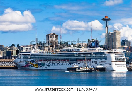 SEATTLE-JULY 21: Norwegian Cruise Line ship docked on July 21, 2012  in Seattle, WA. The Port of Seattle logged a record 933,900 passengers in 2012, bringing $416 million in business revenue. - stock photo