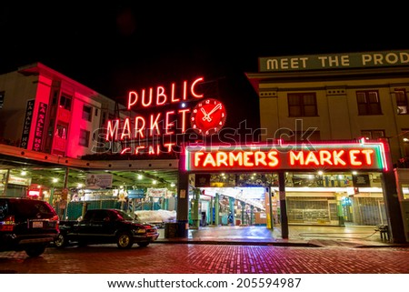 SEATTLE - JULY 5: The Public Market Center also known worldwide as Pike Place Market at night in Seattle, Washington on July 5, 2014. - stock photo
