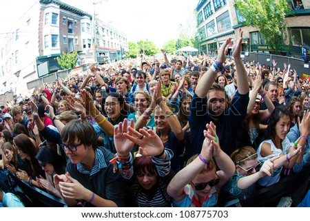 SEATTLE - JULY 22:  Thousands of fans cheer for the Lumineers during the Capitol Hill Block Party in Seattle on July 22, 2012 - stock photo