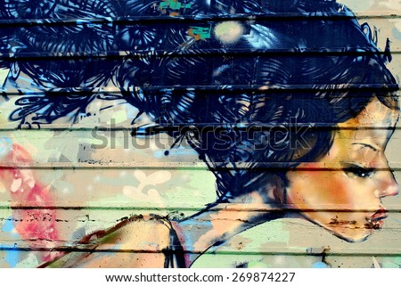 SEATTLE--MARCH 16, 2015.  A wall painting of a woman illustrated outdoors. circa March 2015 in Seattle, Wa. - stock photo