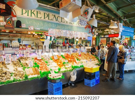 SEATTLE - MAY 9: Stand with tourists at famous Pike Place market on May 9, 2014 in Seattle. The Market opened in 1907, and is one of the oldest continuously operated public farmers' markets in the US. - stock photo