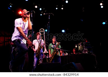 SEATTLE - SEPT 3:  Troy Andrews of Trombone Shorty & Orleans Avenue performs on stage during the Bumbershoot Music festival in Seattle, Washington on September 3, 2011. - stock photo