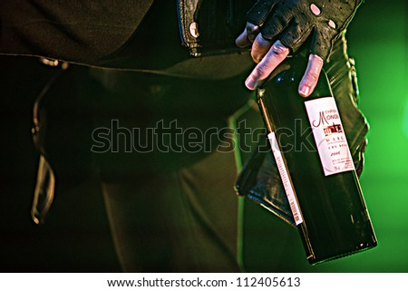 SEATTLE - SEPTEMBER 1, 2012:  A bottle of wine being consumed by lead singer Perry Farrell of Jane's Addiction during Bumbershoot in Seattle, WA on September 1, 2012 - stock photo