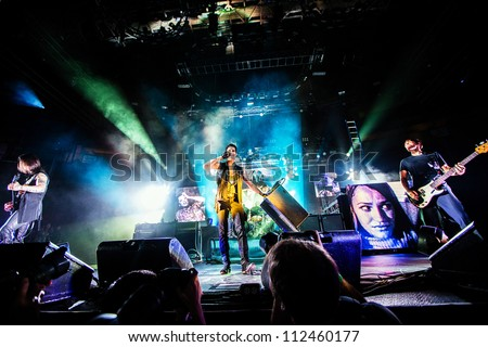 SEATTLE - SEPTEMBER 1, 2012:  Alternative Rock band Jane's Addiction performs on stage at Key Arena in Seattle during the music festival Bumbershoot on September 1, 2012. - stock photo