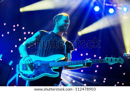 SEATTLE - SEPTEMBER 3, 2012:  French electronic pop band M83 performs on the main stage at Key Arena during the Bumbershoot music festival in Seattle on September 3, 2012. - stock photo