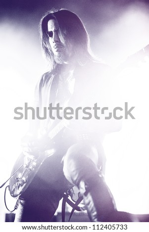 SEATTLE - SEPTEMBER 1, 2012:  Guitarist Dave Navarro of rock band Jane's Addiction performs on the main stage at Key Arena during the Bumbershoot music festival in Seattle on September 1, 2012. - stock photo