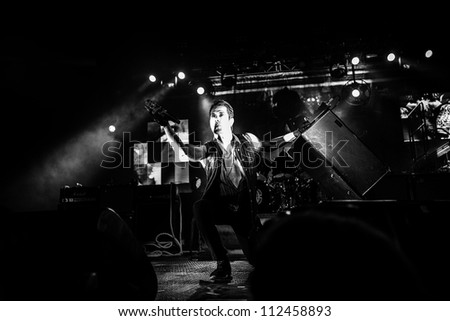 SEATTLE - SEPTEMBER 1, 2012:  Lead singer Perry Farrell of rock band Jane's Addiction performs on stage at Key Arena in Seattle during the music festival Bumbershoot on September 1, 2012. - stock photo